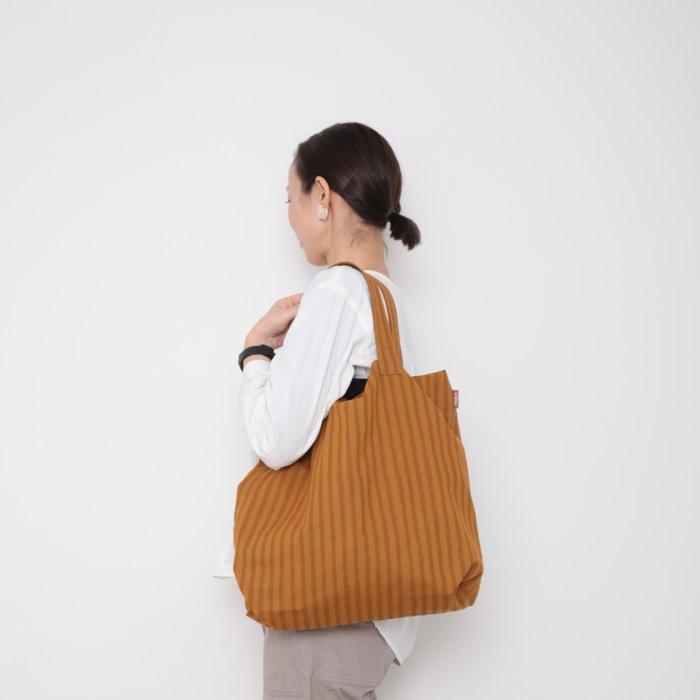 Hand block print kinchaku bag / karashi shima
