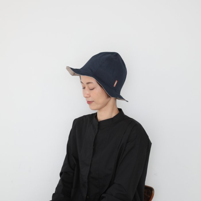 ray hat / navy × light beige