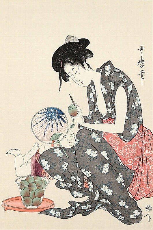 桃をむく母子