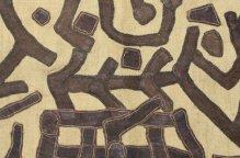 クバ族 記号的な図柄がパッチワークされた布