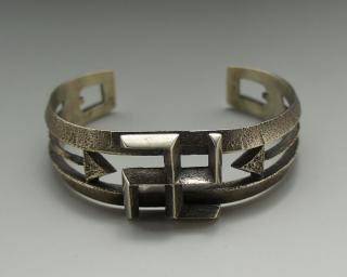 Navajo Aaron Anderson Swastika and Arrow Motif Tufa Cast Bracelet