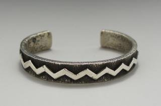 Navajo Ernest Rangel Lightning Design Tufa Cast Bracelet